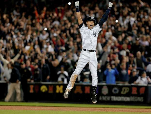 New York Yankees' Derek Jeter jumps after hitting the game-winning single against the Baltimore Orioles in the ninth inning of a baseball game, Thursday, Sept. 25, 2014, in New York. The Yankees won 6-5. (AP Photo/Julie Jacobson) ORG XMIT: NYJJ148 Photo: Julie Jacobson / AP