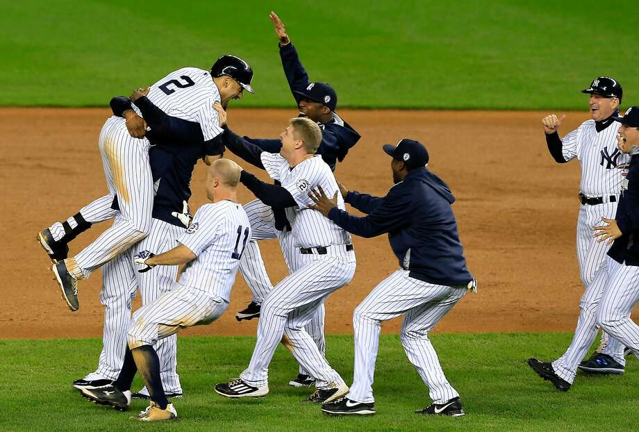 NEW YORK, NY - SEPTEMBER 25:  Derek Jeter #2 of the New York Yankees celebrates with his teammates after a game winning RBI hit in the ninth inning against the Baltimore Orioles in his last game ever at Yankee Stadium on September 25, 2014 in the Bronx borough of New York City.  (Photo by Alex Trautwig/Getty Images) Photo: Alex Trautwig, Getty Images