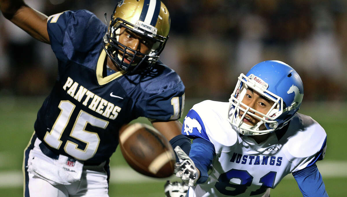 Mustang receiver Michael Moreno stretches away from Panther defender Jekovan Holmes but can't catch the ball as O'Connor hosts Jay at Farris stadium on September. 25, 2014.