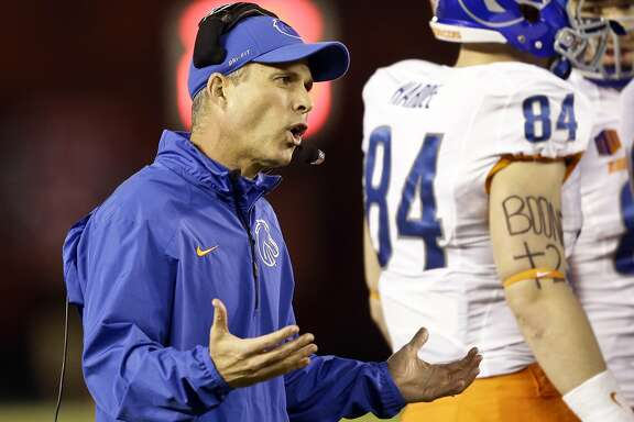 Boise State coach Chris Peterson talks to his team during a timeout against San Diego State in the first half of an NCAA college football game Saturday, Nov. 23, 2013, in San Diego. (AP Photo/Lenny Ignelzi)