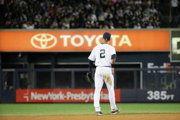 New York Yankees shortstop Derek Jeter heads on to the field during his final home game at Yankee Stadium, Sept. 25, 2014. Jeter's pinstriped No. 2 Yankees jersey,  worn for the last time on Thursday, brings to mind prominent numerals cherished in other sports and eras.  (Michelle V. Agins/The New York Times) ORG XMIT: XNYT Photo: MICHELLE V. AGINS / NYTNS