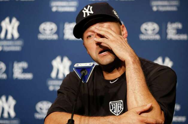 New York Yankees shortstop Derek Jeter wipes his eye during a news conference after his final baseball game at Yankee Stadium in New York, Thursday, Sept. 25, 2014.  The Yankees defeated the Baltimore Orioles 6-5 on Jeter's RBI single. (AP Photo/Kathy Willens) ORG XMIT: NYY205 Photo: Kathy Willens / AP