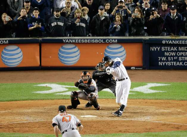 New York Yankees' Derek Jeter (2) hits a single to drive in the winning run against the Baltimore Orioles in the ninth inning of a baseball game, Thursday, Sept. 25, 2014, in New York. The Yankees won 6-5 in Jeter's final home game. (AP Photo/Bill Kostroun)  ORG XMIT: NYJJ157 Photo: Bill Kostroun / AP