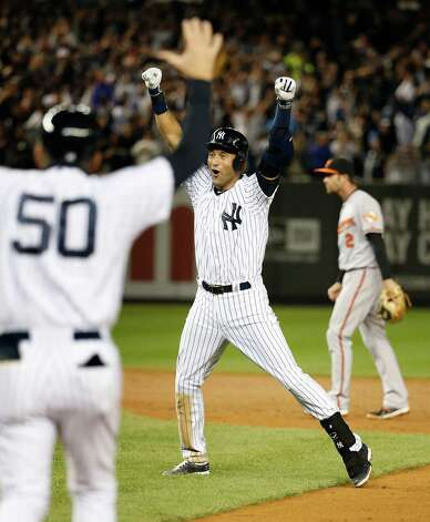 New York Yankees shortstop Derek Jeter celebrates after hitting the game-winning single against the Baltimore Orioles in the ninth inning of a baseball game, Thursday, Sept. 25, 2014, in New York. The Yankees won 6-5 in Jeter's final home game. (AP Photo/Kathy Willens)  ORG XMIT: NYJJ166 Photo: Kathy Willens / AP