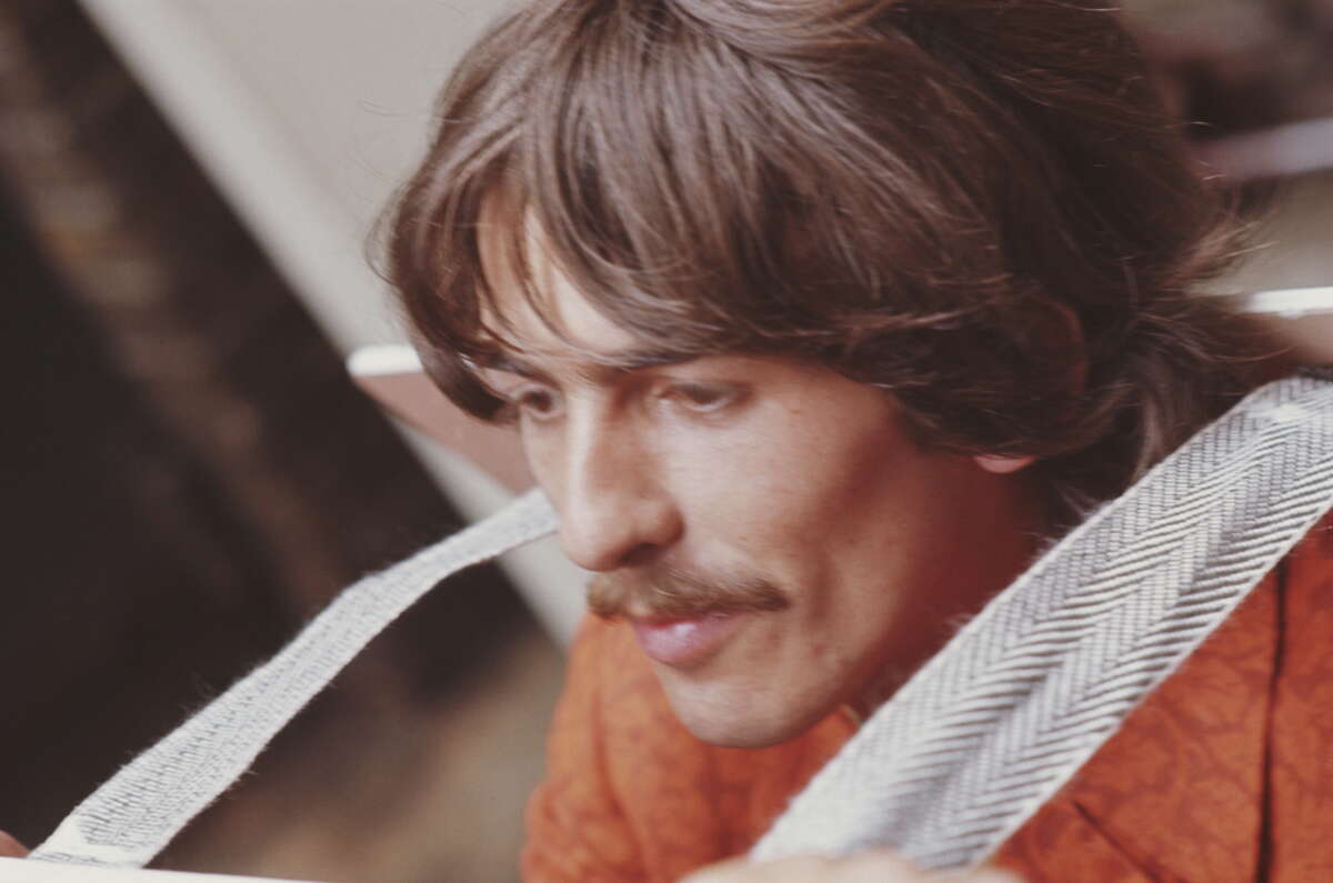 LONDON - 24th JUNE: George Harrison (1943-2001) from The Beatles arrives at EMI Studios in Abbey Road, London for a press call before the recording of 'All You Need is Love' on 24th June 1967.