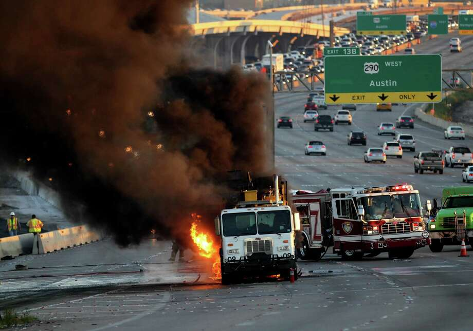Rush-hour traffic came to a standstill when a paint truck caught fire on Sept. 26. Click through to see more of the worst big rig incidents in September. Photo: Gary Coronado, Houston Chronicle / © 2014 Houston Chronicle