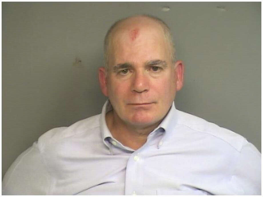 Richard Scully, 61, of 54 Sheep Hill Road, Greenwich, was charged Thursday, Sept. 25, 2014, with driving while under the influence, leaving the scene of an accident, engaging police in pursuit, resisting arrest, driving the wrong way on a one-way street and striking an officer with a motor vehicle. Photo: Contributed Photo / Stamford Advocate Contributed