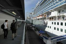 Passengers return to the Crown Princess of the Princess Cruises line which is docked at the new Pier 27 terminal in San Francisco, Calif., on Monday, September 22, 2014. The new terminal will be inaugurated on Thursday, but has already had several large cruise ships dock in the past few weeks, the new cruise terminal at Pier 27 has reshaped the Embarcadero by adding another activity center while strengthening the traditional maritime uses.