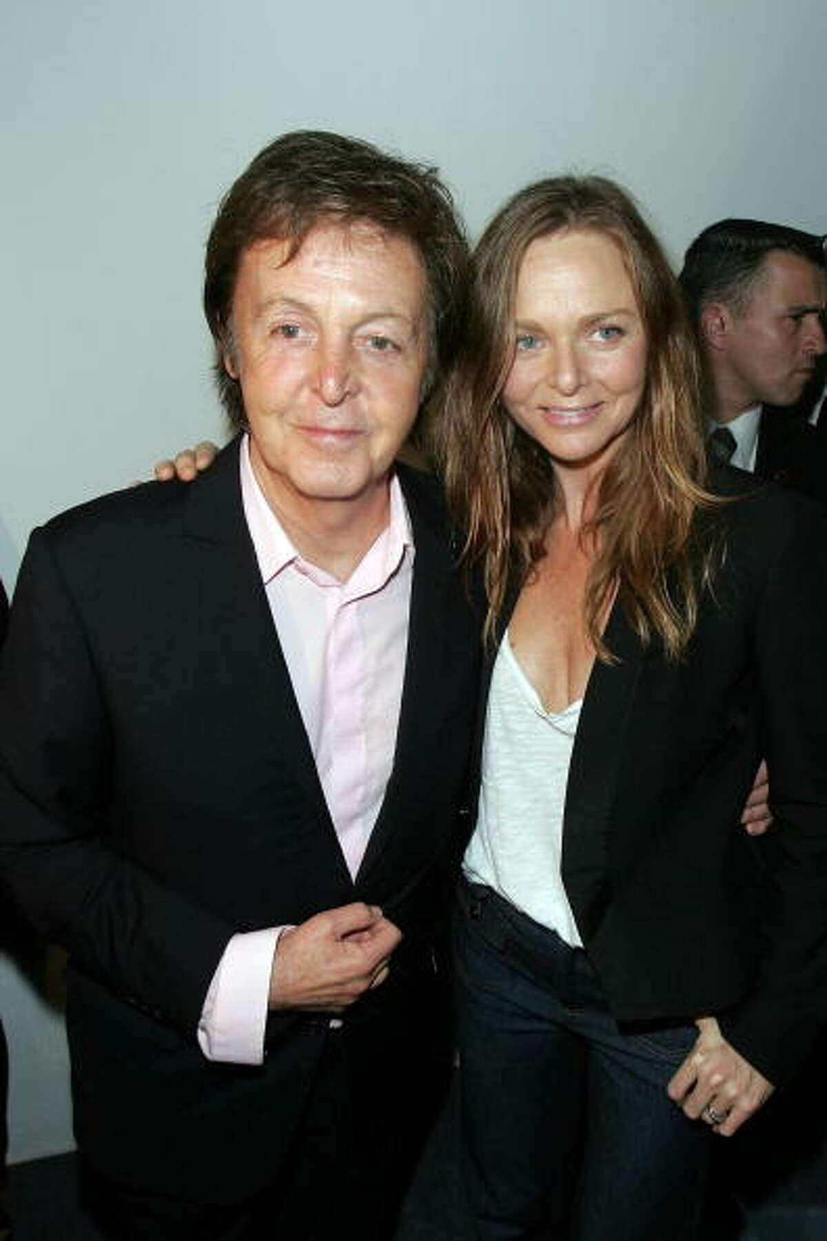 2009: Paul McCartney with daughter Stella McCartney  in Paris, France.