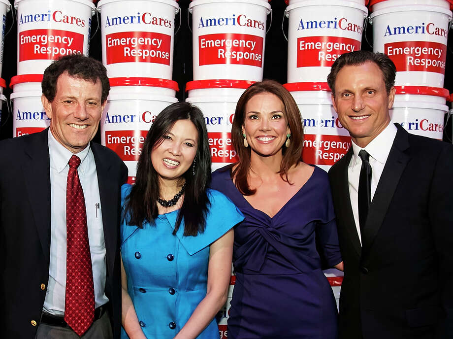 From left, guest speakers Nicholas Kristof and Sheryl WuDunn are joined by Erica Hill and Tony Goldwyn at the 2014 AmeriCares Airlift Benefit at Westchester County Airport last weekend. Photo: Chi Chi Ubina/Contributed Photo, Contributed Photo / Greenwich Time Contributed