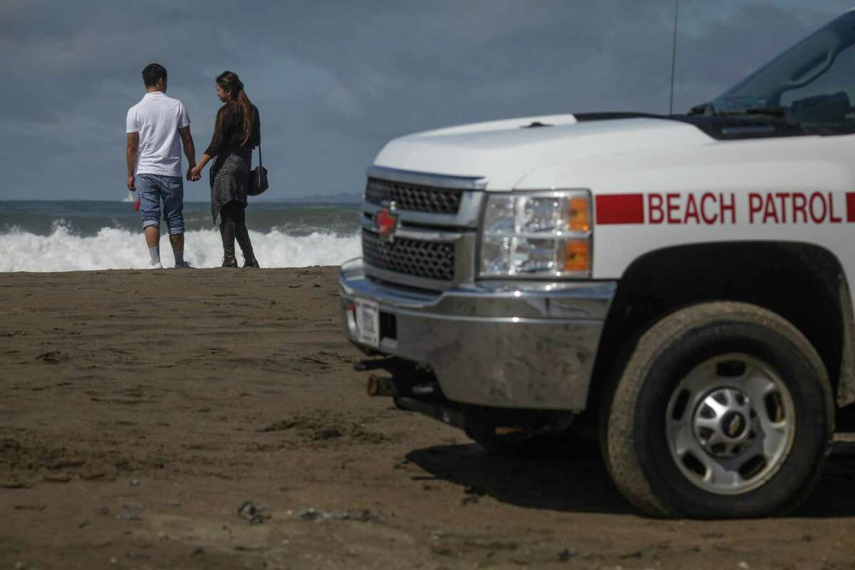 Eric Liao and Annie Huang visit Ocean Beach in S.F., where a father and son from the San Joaquin Valley died after swimming in the storm-whipped surf.
