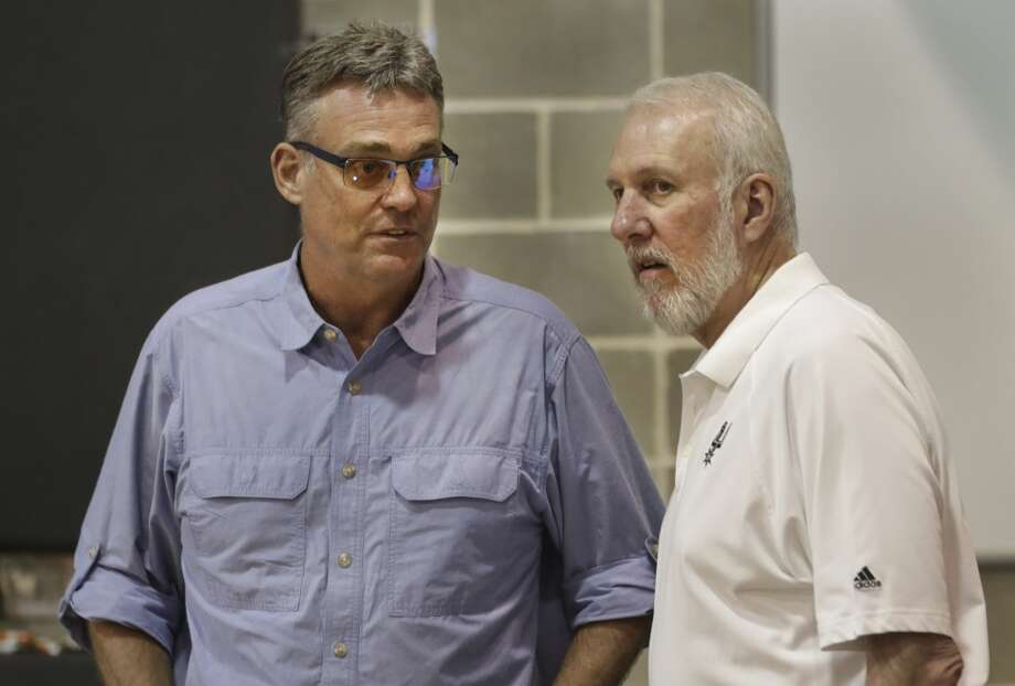 R.C. Buford, left, and Gregg Popovich chat during the San Antonio Spurs media day at their practice facility.   Friday, Sept. 26, 2014. Photo: Bob Owen, San Antonio Express-News