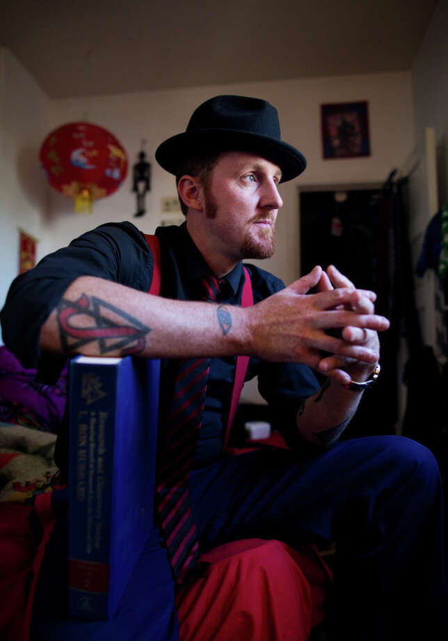 Slam poet Jamie DeWolf is the harshest critic of his great-grandfather L. Ron Hubbard. Photo: TIM HUSSIN / Special To The Chronicle / ONLINE_YES