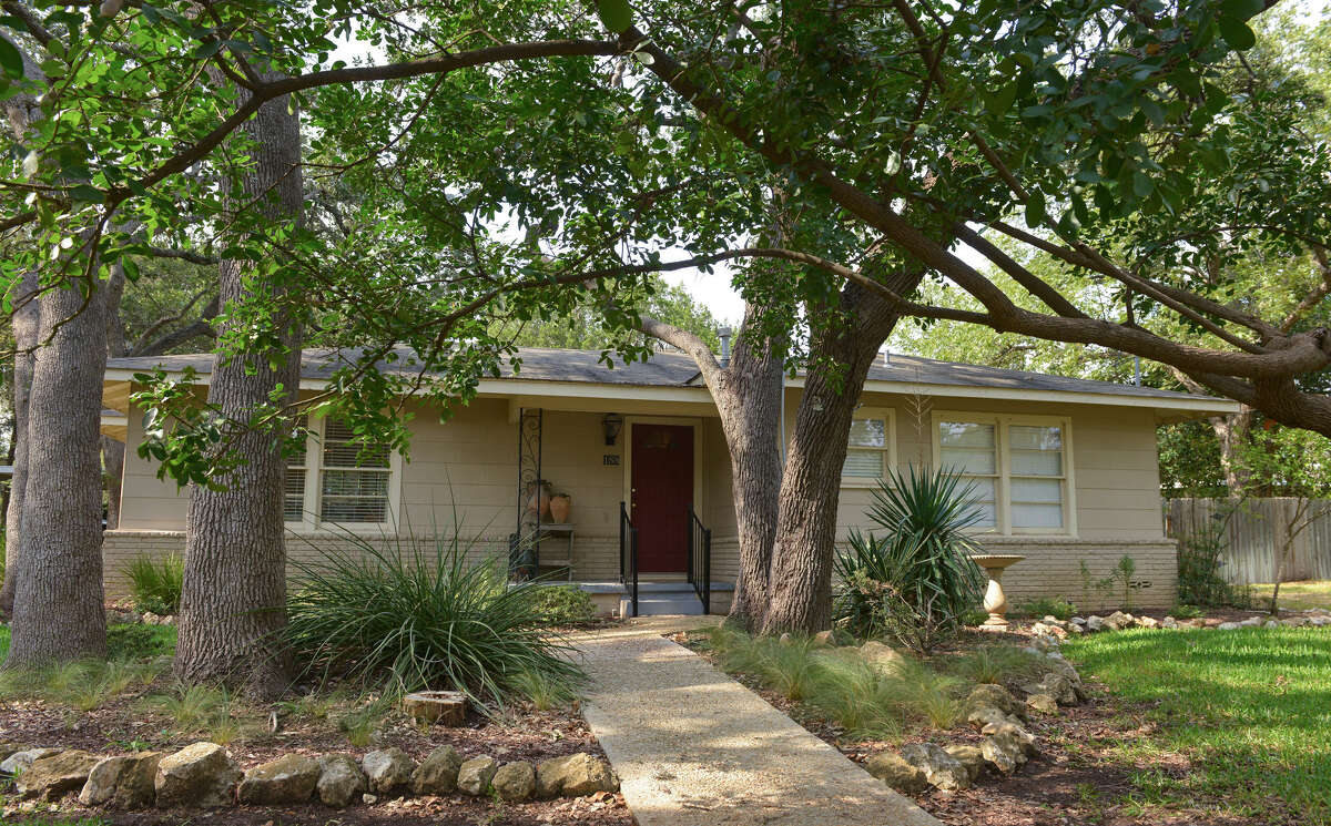 Large oak and pecan trees shade the 1954 house Gordon updated.