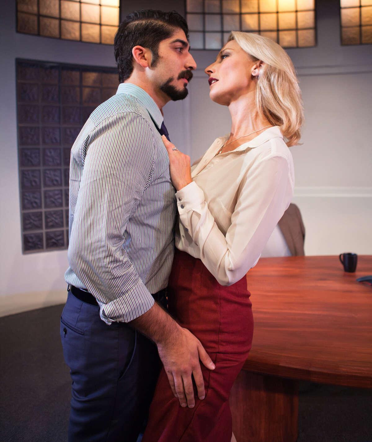Co-workers Sandeep (Jason Kapoor, left) and Hannah (Carrie Paff)) are having an affair.