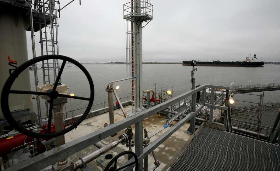 An oil tanker passes the terminal docks of Cheniere LNG. (Steve Ueckert / Chronicle / 2008) Photo: Steve Ueckert, Houston Chronicle