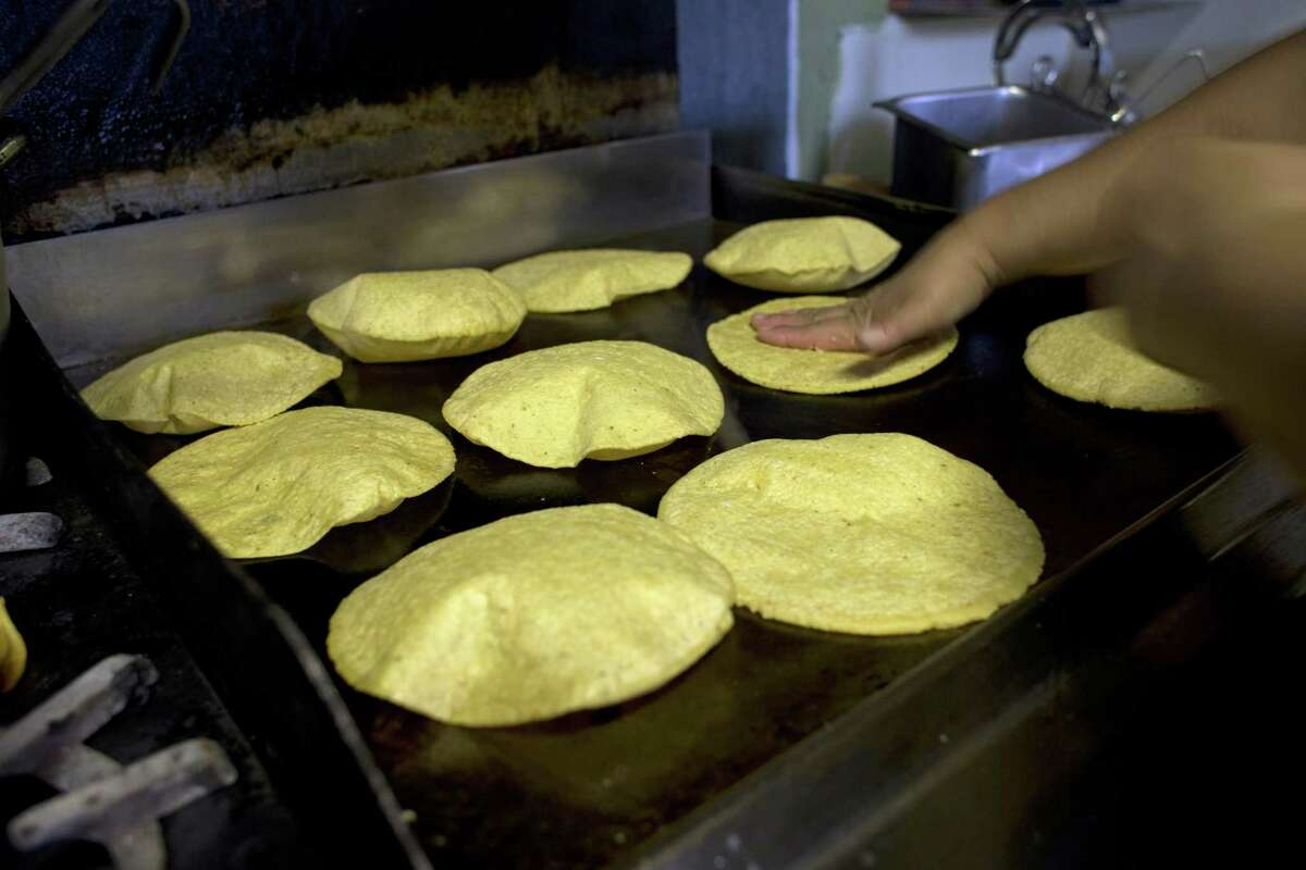 Margarita Lopez prepares fresh tortillas for the menudo at Taqueria Campos in Oakland.