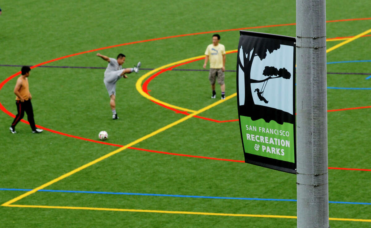 Soccer players practice on the Minnie and Lovie Ward Rec Center fields, which recently reopened with artificial turf.