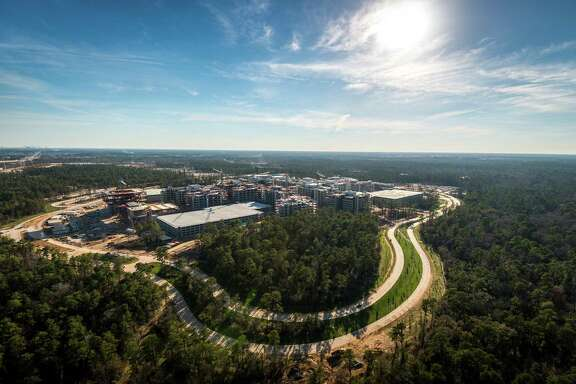 The Exxon Mobil corporate campus under construction near The Woodlands continues to draw real estate developers. On Friday, Hines announced it will build an upscale residential community nearby. ( Smiley N. Pool / Houston Chronicle )