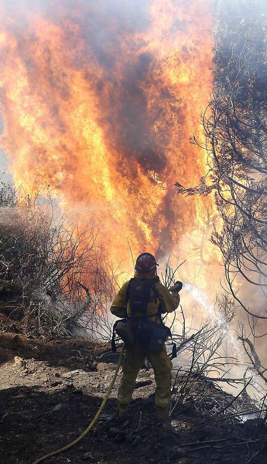 The King Fire, a massive blaze in California's Eldorado National Forest,  has burned 145 square miles, even stretching into Nevada as of Sept.  24, 2014. State officials say the fire, which started on Sept. 13, has become the second-most expensive blaze to fight in California this year. Photo: Rich Pedroncelli, Associated Press