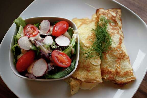 These crepes are served with a salad. They may look hard to make, but they're not and they can make a weeknight dinner seem special.