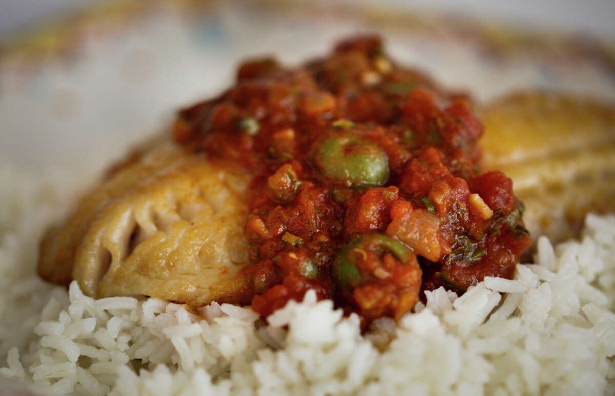 Snapper with Salsa Veracruzana from Gonzalo Guzman of Nopalito is seen on Tuesday, Sept. 23, 2014 in San Francisco, Calif. The dish comes from the Veracruz region of Mexico.
