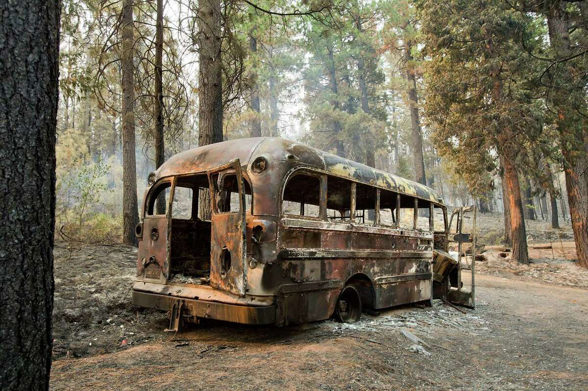 A burned bus is left in the wake of the King Fire near Icehouse in El Dorado County. Heavy rains this week helped firefighters begin to gain the upper hand on the blaze.