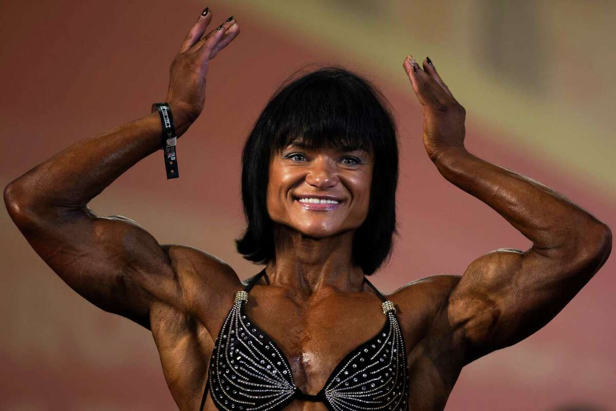 A competitor flexes her muscles during one of the women categories at the Arnold Classic Europe bodybuilding event in Madrid, Spain, Friday, Sept. 26, 2014.