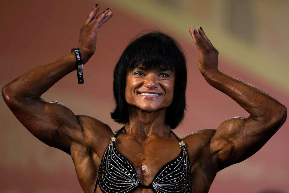 A competitor flexes her muscles during one of the women categories at the Arnold Classic Europe bodybuilding event in Madrid, Spain, Friday, Sept. 26, 2014.  Photo: Andres Kudacki, Associated Press / AP