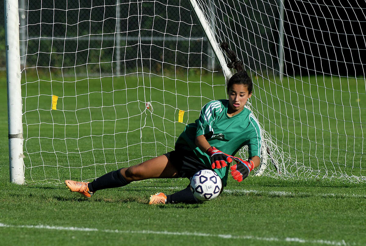 New Canaan's Katie Donovan makes a save during Friday's girls soccer game in New Canaan, Conn., on September 26, 2014.