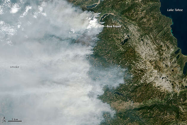 The King Fire, a massive blaze in California's Eldorado National Forest, has burned 145 square miles, even stretching into Nevada as of Sept. 24. State officials say it has become the second-most expensive fire in 2014. In the above photo, taken by NASA satellites, you can see smoke plumes rising from the edge of the fire. Photo: Jesse Allen, NASA Earth Observatory