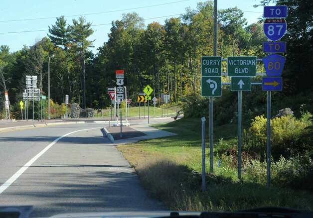 Detour signs are seen at a round about near Round Lake on Friday, Sept. 26, 2014 in Saratoga Springs, N.Y. The Mechanicville bridge is closed except for a pedestrian walkway. The detour signs lead to Exit 9. (Lori Van Buren / Times Union) Photo: Lori Van Buren