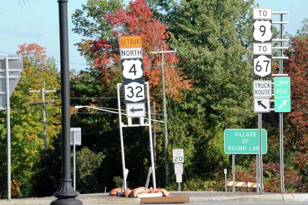 Detour signs are seen at a round about near Round Lake on Friday, Sept. 26, 2014 in Saratoga Springs, N.Y. The Mechanicville bridge is closed except for a pedestrian walkway.  (Lori Van Buren / Times Union) Photo: Lori Van Buren