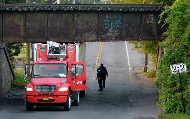 A Coca Cola tractor trailer got stuck under the railroad overpass on Crane Street early Friday morning Sept. 26, 2014 in Schenectady, N.Y.  Schenectady Police are investigating.  No injuries were reported.   (Skip Dickstein/Times Union) Photo: SKIP DICKSTEIN