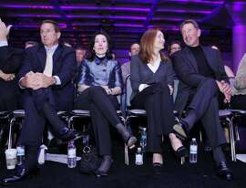 Oracle Corp. CEO Larry Ellison, right, with his wife, Melanie Ellison, second from right, Oracle's co-Presidents Mark Hurd, left, and Safra Catz, listen during a keynote address, Wednesday, Sept. 22, 2010, at Oracle World in San Francisco. Hurd is the former CEO of Hewlett-Packard Co.