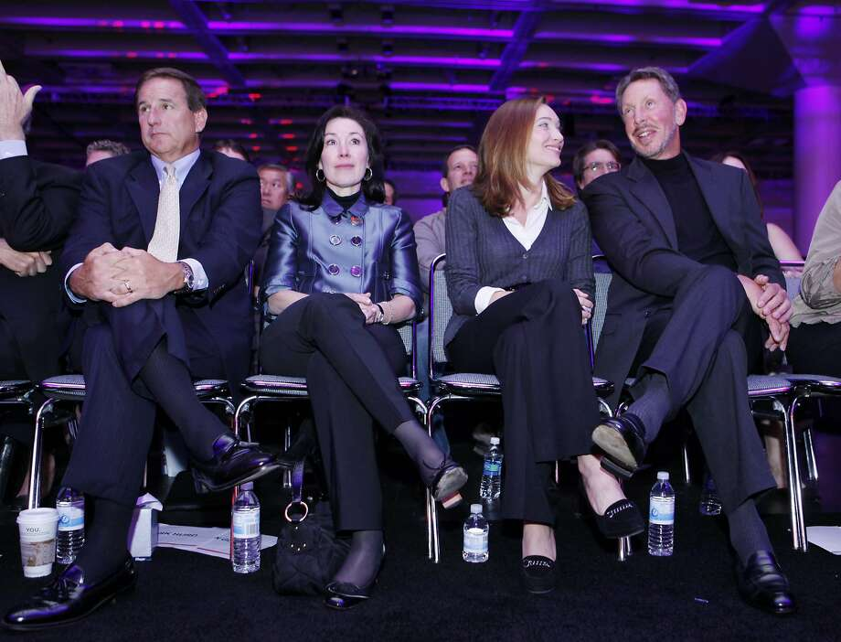 Oracle Corp. CEO Larry Ellison, right, with his wife, Melanie Ellison, second from right, Oracle's co-Presidents Mark Hurd, left, and Safra Catz, listen during a keynote address, Wednesday, Sept. 22, 2010, at Oracle World in San Francisco. Hurd is the former CEO of Hewlett-Packard Co. Photo: Paul Sakuma, AP