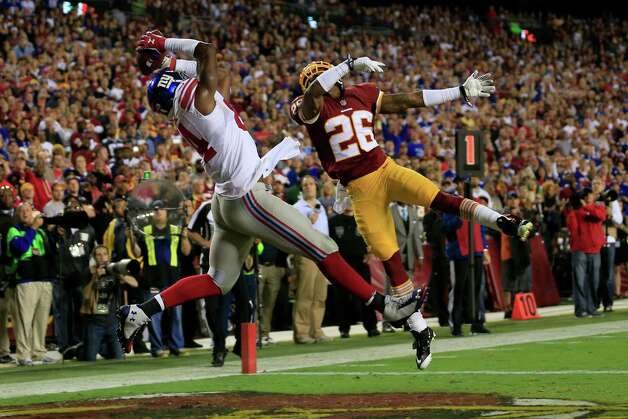LANDOVER, MD - SEPTEMBER 25: Tight end Larry Donnell #84 of the New York Giants catches a pass for a touchdown in the second quarter at FedExField on September 25, 2014 in Landover, Maryland. (Photo by Rob Carr/Getty Images) ***BESTPIX*** ORG XMIT: 504251933 Photo: Rob Carr / 2014 Getty Images