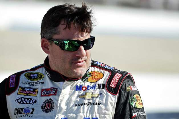 DOVER, DE - SEPTEMBER 26: Tony Stewart, driver of the #14 Bass Pro Shops/Mobil 1 Chevrolet, stands on pit road during qualifying for the NASCAR Sprint Cup Series AAA 400 at Dover International Speedway on September 26, 2014 in Dover, Delaware.  (Photo by Patrick Smith/Getty Images) ORG XMIT: 514637359 Photo: Patrick Smith / 2014 Getty Images