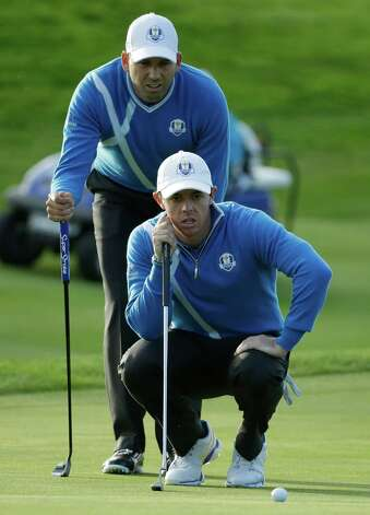 Europe's Sergio Garcia and Rory McIlroy, front, line up a putt on the 15th green during the foursomes match on the first day of the Ryder Cup golf tournament at Gleneagles, Scotland, Friday, Sept. 26, 2014. (AP Photo/Matt Dunham) ORG XMIT: RCUP364 Photo: Matt Dunham / AP