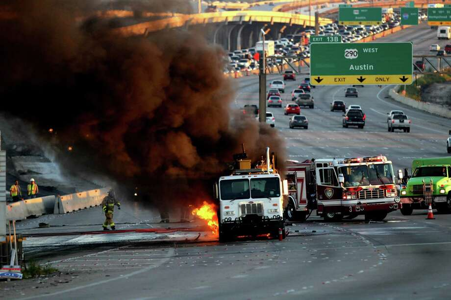 Rush-hour traffic came to a standstill early Friday on the West Loop after a road-striping truck caught fire. Such incidents are on the rise. Photo: Gary Coronado, Staff / © 2014 Houston Chronicle