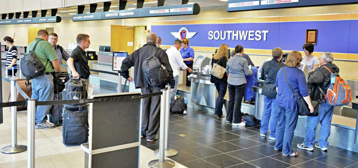 Busy ticket counters at Albany Airport after a fire at a suburban air traffic control center in Illinois disrupted flights Friday Sept. 26, 2014. (John Carl D'Annibale / Times Union)