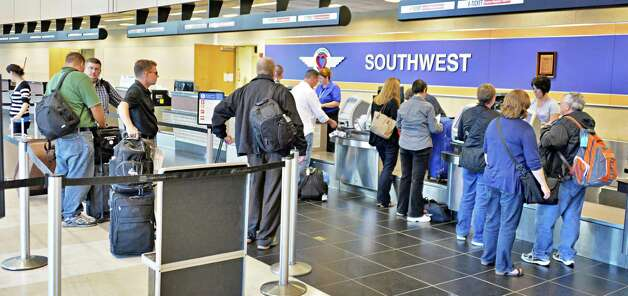 Busy ticket counters at Albany Airport after a fire at a suburban air traffic control center in Illinois disrupted flights Friday Sept. 26, 2014.   (John Carl D'Annibale / Times Union) Photo: John Carl D'Annibale
