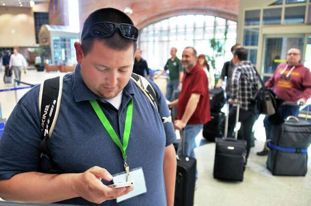 Nick Smith of Hanover Park, Ill.,  in line at a ticket counter at Albany Airport after a fire at a suburban air traffic control center in Illinois disrupted flights Friday Sept. 26, 2014.   (John Carl D'Annibale / Times Union) Photo: John Carl D'Annibale