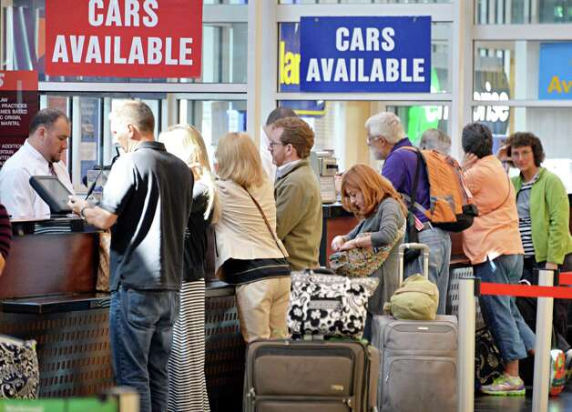 Busy car rental counters at Albany Airport after a fire at a suburban air traffic control center in Illinois disrupted flights Friday Sept. 26, 2014.   (John Carl D'Annibale / Times Union) Photo: John Carl D'Annibale