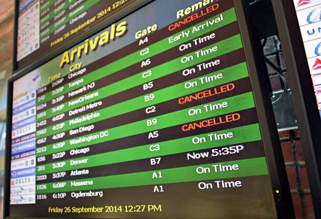 Canceled flights are displayed on the arrivals board at Albany Airport after a fire at a suburban air traffic control center in Illinois Friday Sept. 26, 2014.   (John Carl D'Annibale / Times Union) Photo: John Carl D'Annibale