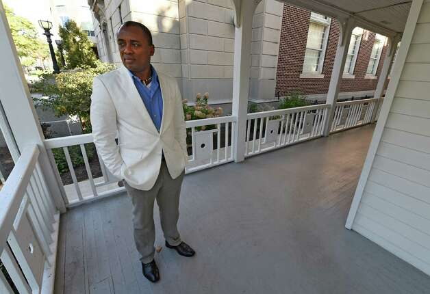 Professor Marda Mustapha of Sierra Leone stands on the front porch of Moran Hall Friday morning, Sept. 26, 2014, on the Saint Rose College campus in Albany, N.Y. (Skip Dickstein/Times Union) Photo: SKIP DICKSTEIN / 00028767A