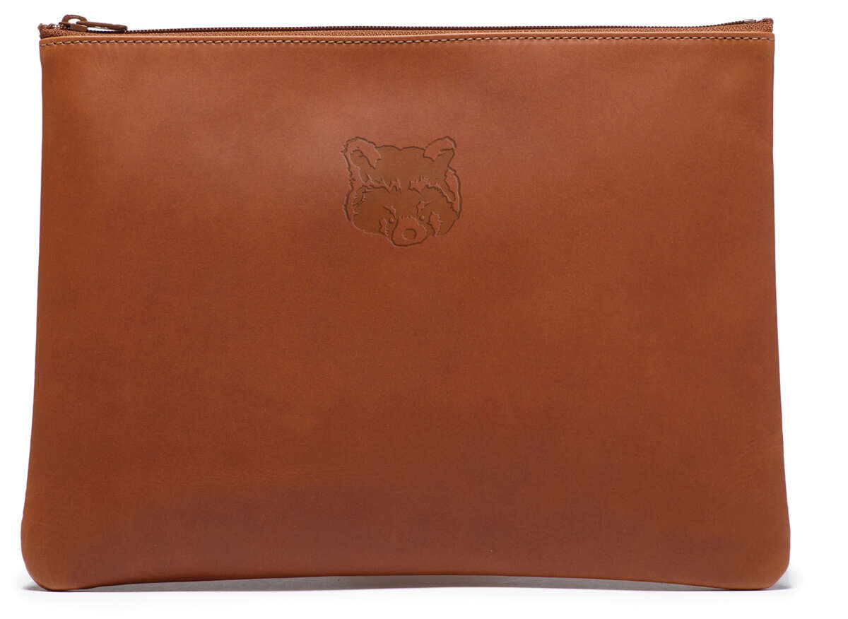 Ghurka's limited-edition red panda leather pouch, available exclusively in S.F., is a gift with any women's purchase while supplies last.