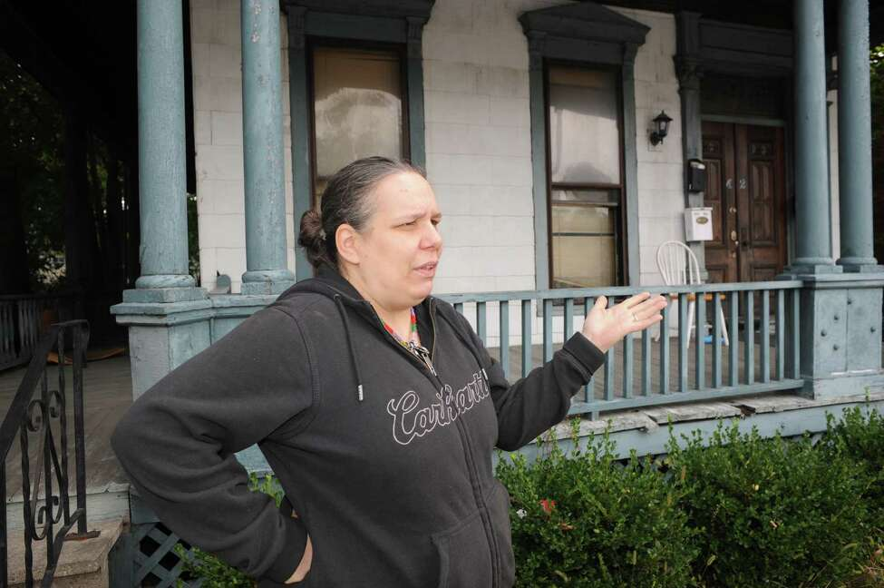 Troy 5th Avenue resident Heaven Muzzy talks about the water in his apartment being turned off on Thursday, Sept. 25, 2014, in Troy, N.Y. (Michael P. Farrell/Times Union)