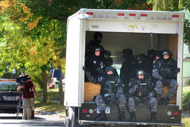 Schenectady Police S.W.A.T team members load up after a standoff at 315-317 McClellan Street on Friday Sept. 26, 2014 in Schenectady, N.Y.  (Michael P. Farrell/Times Union) Photo: Michael P. Farrell
