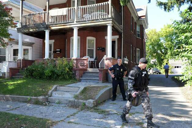 Schenectady Police work the scene after a standoff at 315-317 McClellan Street on Friday Sept. 26, 2014 in Schenectady, N.Y.  (Michael P. Farrell/Times Union) Photo: Michael P. Farrell
